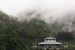 Sun Moon Lake ropeway. And station building with the forest background and white mist covering the top of trees stock image
