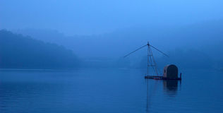 Sun Moon Lake. Taiwan、Sun Moon Lake 、The surface of the water、Fishing boats、The early morning、The mist Royalty Free Stock Photos