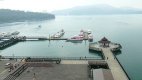 Pier at Sun Moon Lake, the largest body of water in Taiwan. SUN MOON LAKE, TAIWAN - OCTOBER 26, 2019: Pier at Sun Moon Lake, the largest body of water in Taiwan stock footage