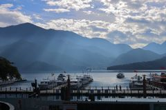 Sun Moon Lake Yuchi Nantou county Taiwan. December 09 2018 : View of Sun Moon Lake with the passenger boats waiting at the numerous piers royalty free stock photos