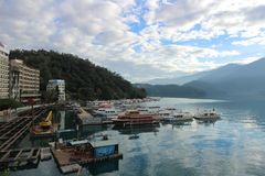 Sun Moon Lake Yuchi Nantou county Taiwan. December 09 2018 : View of Sun Moon Lake with the passenger boats waiting at the numerous piers stock photo