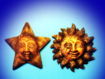 Sun and moon. Made from clay on blue background Royalty Free Stock Photography