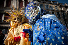 Sun and moon mask. In san marco plaza during the carnival of venice Stock Photo