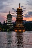 Sun and moon pagodas in Guilin, China. Pagodas on lake at sunset royalty free stock image