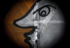 Sun / moon. Painted on iron door. Street art. Close-up Royalty Free Stock Photography