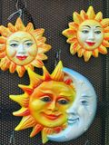 Sun and Moon Plaques, Italy. Smiling sun and moon plaques, tiles, wall hangings. A generic image but actual location is Sermione, Italy Royalty Free Stock Photography