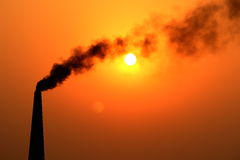The sun, the moon and pollution Royalty Free Stock Photos