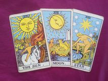 Sun moon star tarot cards. Tarot cards sun moon star on purple background Stock Images