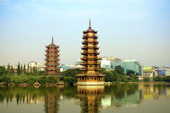 Sun and the moon tower,China. Golden tower and silver tower in the lake stock images