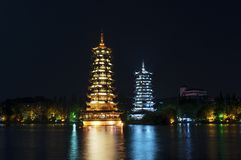 The Sun and Moon Twin Pagodas illuminated at nigh in the city of Guilin royalty free stock images