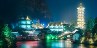 Sun and Moon Twin Pagodas on Shanhu Lake Guilin. The Sun and Moon Twin Pagodas on Shanhu Lake at night in Guilin, Li River and Karst mountains Yangshuo and royalty free stock photo