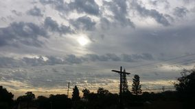 Sun morning. Morning sky& x27;s cloudy cross Stock Photo