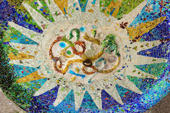 Sun of mosaic. Park Guell sun detail of mosaic designed by Antonio Gaudi Stock Images