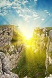 Sun in a mountain crack Stock Images