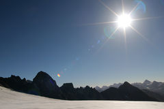 Sun in the mountains. Mountain view with bright sun Stock Photography