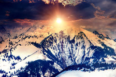 Sun in mountains on cloud sky background Stock Photography