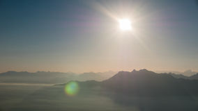 Sun and mountains. The sun high in the sky above mountains Royalty Free Stock Images