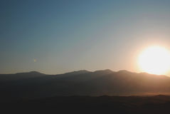 Sun, mountains and sunrise over  the mountains Royalty Free Stock Image