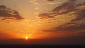 The sun moves on the sunset sky with clouds stock footage