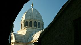 Sun moving above old basilica stock footage
