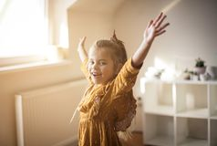 Sun is my energies. Little girl at home royalty free stock photos