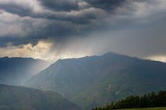 Sun in myst over mountains Stock Photos