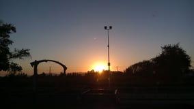 Sun no horizonte Imagem de Stock Royalty Free