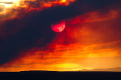 Sun obscured by wildfire smoke. Smoke from a wildfire in New Mexico obscures the sun and creates an eerie atmosphere Stock Images