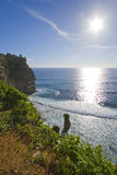 Sun Ocean and Cliff. Bright sunshine over the ocean next to a cliff in Bali, Indonesia royalty free stock photos
