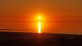 Sun and orange sky over sea Stock Photo