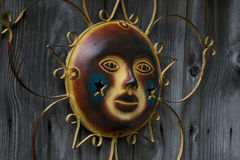 Sun Ornament in Awe on Old Barn Royalty Free Stock Images