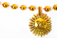 Sun ornament and beads Royalty Free Stock Images
