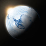 Sun over Antarctica on planet Earth. Sun over Antarctica on blue planet Earth on black background. Highly detailed planet surface. Elements of this image royalty free illustration