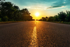 Sun over asphalt road Royalty Free Stock Photo