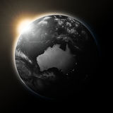 Sun over Australia on dark planet Earth Royalty Free Stock Photo