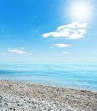 Sun over beach Royalty Free Stock Images