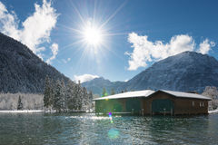 Sun Over Boat House At Sunny And Snowy Winter Day Stock Images
