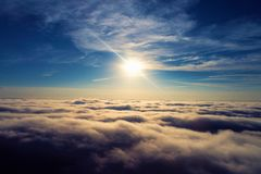 Sun over clouds with a blue sky and great landscape. Freedom. Fantastic landscape. Peace, Freedom, overcoming, God. Great sky view! Great colors and contrast royalty free stock images