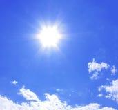 Sun over clouds. On clear blue sky Stock Photos