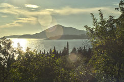 The sun over the coast of the Adriatic Sea. Beach close to Sveti Stefan, Montenegro Royalty Free Stock Photo