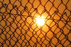 Sun over the Cyclone Fence Royalty Free Stock Images