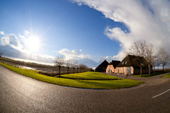 Sun over Dutch farm house, fisheye view Stock Photography