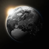 Sun over Europe on dark planet Earth Stock Photos