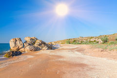 Sun over exotic beach Stock Images