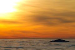 Sun over fog in black forest Stock Image