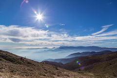 Sun over the fog in the mountain Royalty Free Stock Images