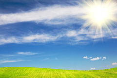 Sun over the green field in summer royalty free stock photography