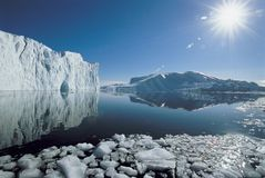 Sun over icebergs and ocean Stock Photo