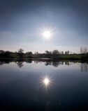 Sun over lake Stock Photo
