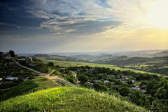 Sun over mountain countryside Royalty Free Stock Photography